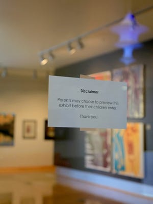 A disclaimer on the door of the Sears Art Museum Gallery at Dixie State University in St. George advises parents to preview the most recent art show because it contains depictions of the human figure.