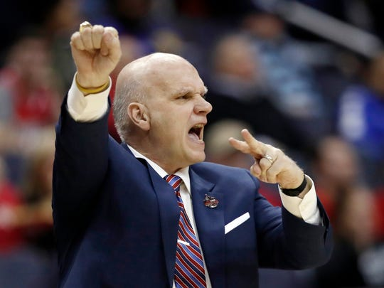 FILE - In this March 10, 2018, file photo Saint Joseph's head coach Phil Martelli directs his team during the first half of an NCAA college basketball semifinal game against Rhode Island in the Atlantic 10 Conference tournament in Washington. Saint Joseph's fired Martelli on Tuesday, March 19, 2019, after 24 seasons. The 64-year-old Martelli became head coach in 1995 after 10 years as an assistant.  (AP Photo/Alex Brandon, File)