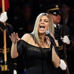 Watch Fergie give bizarre national anthem performance as NBA players try not to laugh