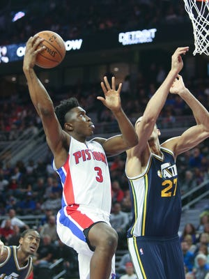 Pistons forward Stanley Johnson scores against Jazz center Rudy Gobert Wednesday at the Palace.