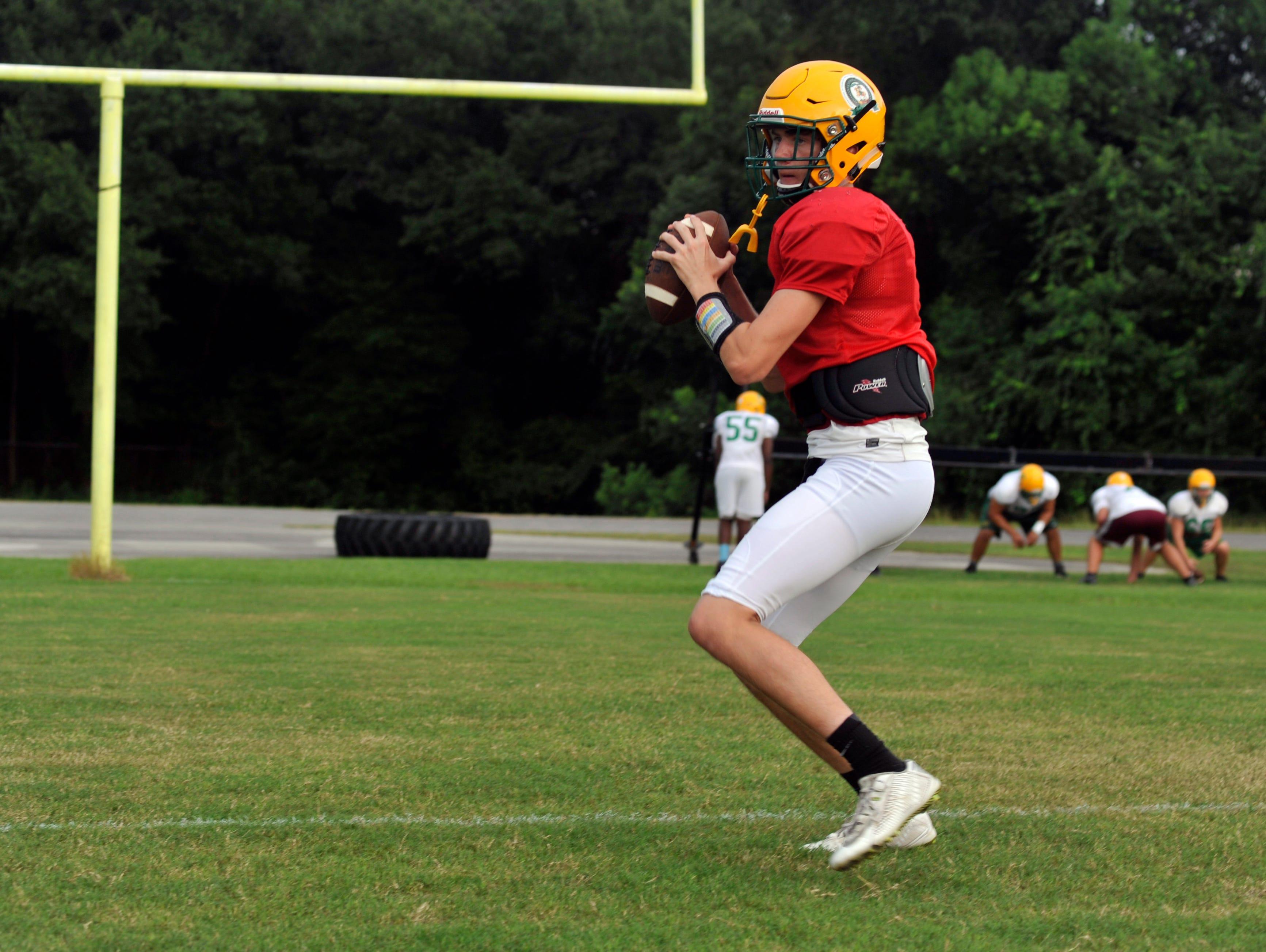 Pensacola Catholic quarterback Garrett Foley takes reps prior to Friday's game against Navarre.