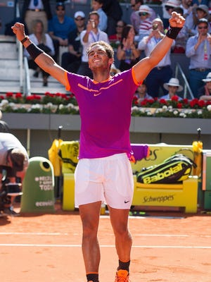 Rafael Nadal of Spain celebrates after beating Novak Djokovic of Serbia in their semi-final match during day eight of the Mutua Madrid Open tennis at La Caja Magica on May 13, 2017 in Madrid, Spain. (Photo by Denis Doyle/Getty Images)