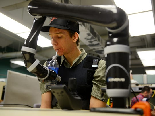 MSU senior Sanders Aspelund tests a robotic arm for