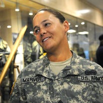 Staff Sgt. Amity Marver talks about her military service and the role of women in combat on Wednesday for Women's Equality Day at Camp Ripley. Marver served in Iraq and is one of 50 women in the Minnesota National Guard to receive the combat action badge.