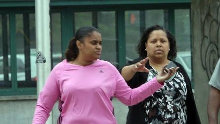 Nicole Diggs, 31, of Yonkers, left, walks into the Westchester County Courthouse accompanied by her aunt, in White Plains June 11, 2014. Diggs, along with her husband Oscar Thomas, are charged in the death of Diggs' daughter, 8-year-old Alayah-Rose Savarese. The severely disabled Yonkers girl was found dead in her apartment two years ago.