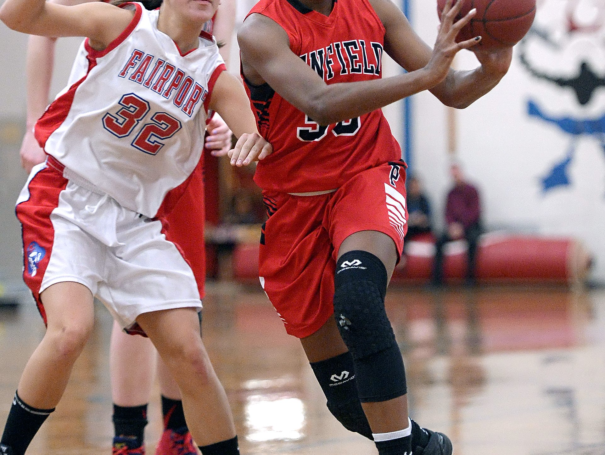 Penfield sophomore guard Makaila Wilson, passes the ball during Tuesday's win at Fairport.