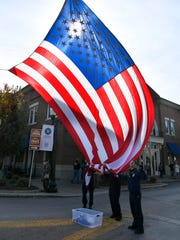 Franklin firemen lower a large American flag after the Franklin Veterans Day Parade in downtown Franklin on Nov. 10, 2017. Vietnam Veterans of America will hold a second organizational meeting to form a Williamson County chapter from 6-7:30 p.m. Thursday, Feb. 14, at the Williamson County Public Library in Franklin.