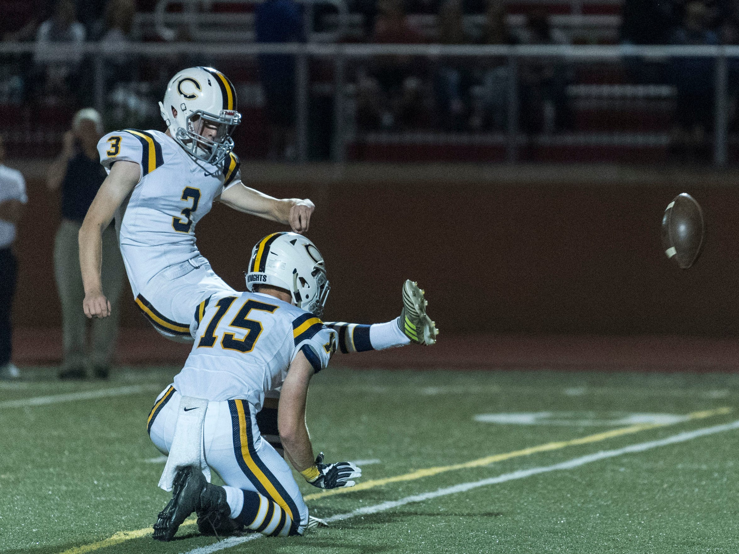 Castle's Brock Wandel (3) punts the ball for an extra point after a touchdown against the Harrison Warriors at Romain Stadium in Evansville, Ind., Friday, Sept. 29, 2017. The Knights defeated the Warriors, 51-3.