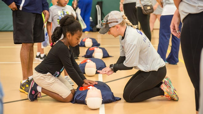 A youngster learns CPR at Health First safety training event. The Health First 'Save a Life' Day, which is free,runs from 8 a.m. to 11 a.m. Saturday at Melbourne Auditorium,625 E. Hibiscus Blvd., Melbourne.