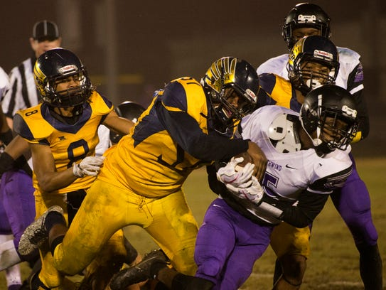 Rakeem Savusa, 57, goes in to tackle a Southwind player