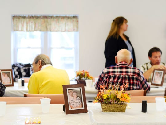 Photographs of Paul and Mary Alwood decorate each table. The couple lives on through their family legacy of 24 grandchildren, 40 great-grandchildren and 22 great-great-grandchildren.