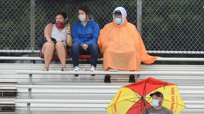 Fans watch the pregame entertainment prior to the Northside-Southside football game on Thursday in Mayo-Thompson Stadium.