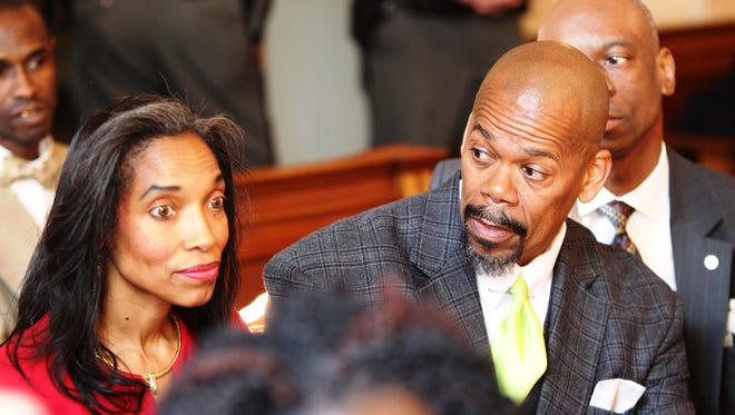 Tracie Hunter in court with attorney Clyde Bennett II.