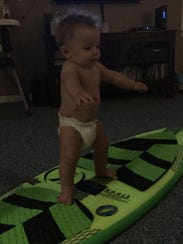 Eight-month-old Malakye Pierce practicing holding his
