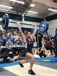 Vero Beach's Jayda Jenkins finishes a clean and jerk