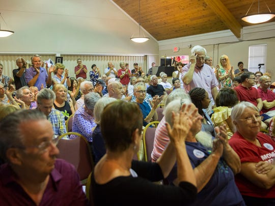 Chuck Nelson, 74, receives applause and a standing