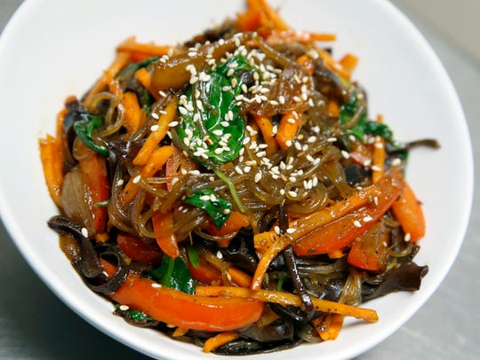 Japchae is served at Lanai in the former home of Mex