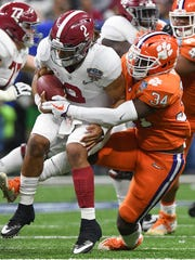 Clemson linebacker Kendall Joseph (34) sacks Alabama quarterback Jalen Hurts (2) during the 1st quarter of the Allstate Sugar Bowl at the Mercedes-Benz Superdome in New Orleans on Monday, January 1, 2018.
