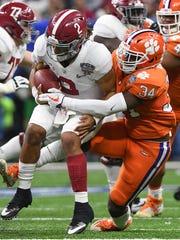 Clemson linebacker Kendall Joseph (34) sacks Alabama