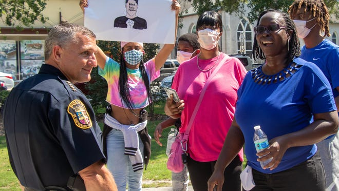 Activist Nichol Sparrow, right, speaks with St. Augustine Police Chief Barry Fox after a May 31 protest against the killing of unarmed black men by law enforcement. Sparrow and Fox were able to share a laugh after the hour-long protest at the Plaza de la Constitucion in downtown St. Augustine.