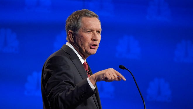 Gov. John Kasich speaks during the CNBC Republican presidential debate at the University of Colorado on Wednesday.