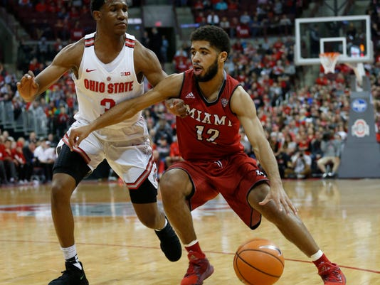 Miami of Ohio's Darrian Ringo, right, drives to the basket against Ohio State's C.J. Jackson during the first half of an NCAA college basketball game Saturday, Dec. 30, 2017, in Columbus, Ohio. (AP Photo/Jay LaPrete)