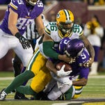 Minnesota Vikings quarterback Teddy Bridgewater (5) is sacked by Green Bay Packers linebacker Mike Neal (96) during the second quarter at TCF Bank Stadium.