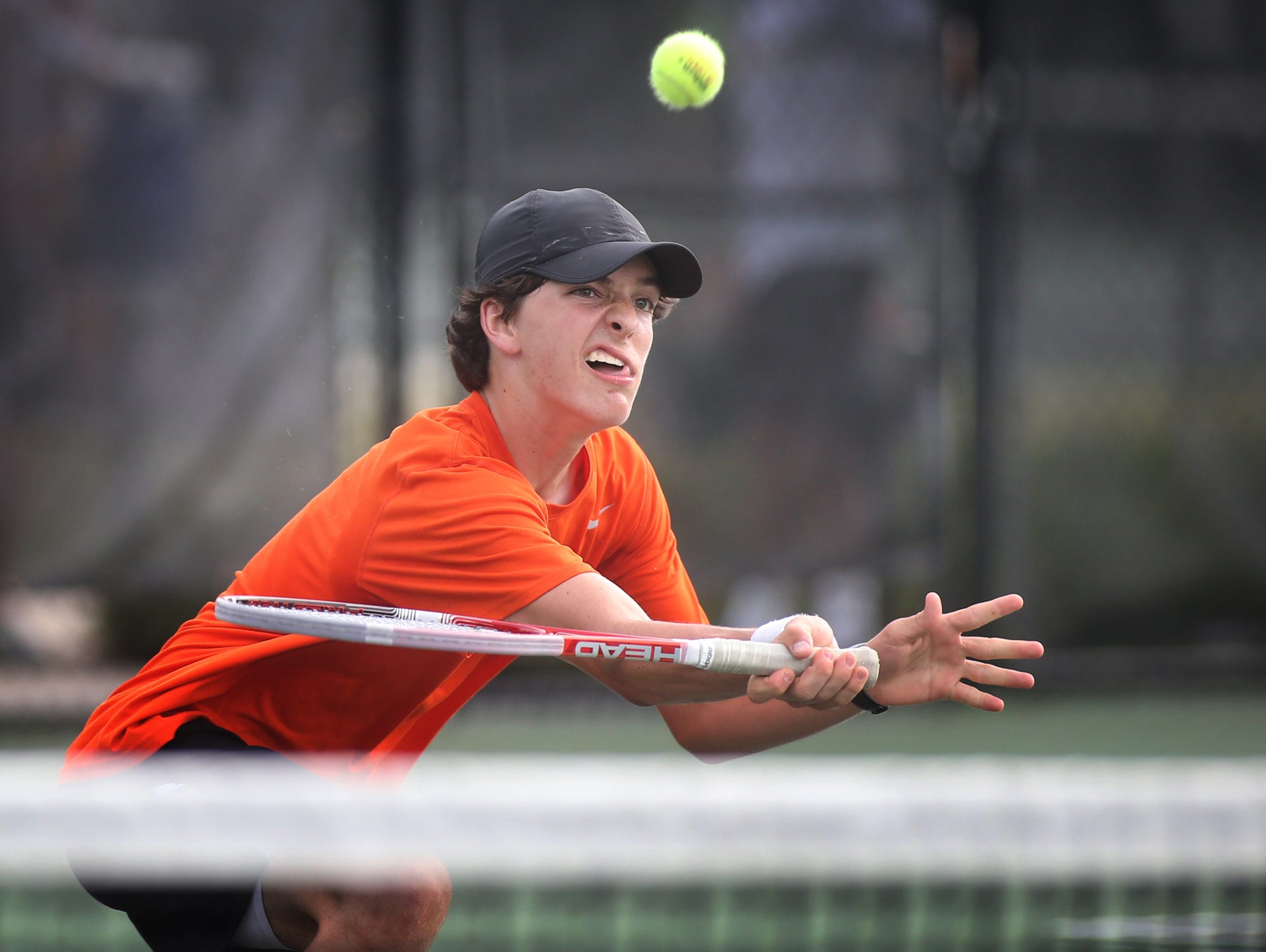 MTCS's Thomas Goodwyn returns a ball during a doubles semifinals match in the CLass A/AA state tournament at Old Fort Park. Goodwyn's partner was Will Reeves. HELEN COMER / DNJ MTCS's Thomas Goodwyn returns a ball during a doubles semi-finals A-AA TSSAA Class A-AA State Tournament Doubles Tennis Game during Spring Fling at Old Fort Park on Thursday, May 22, 2014. Goodwyn's partner is Will Reeves.
