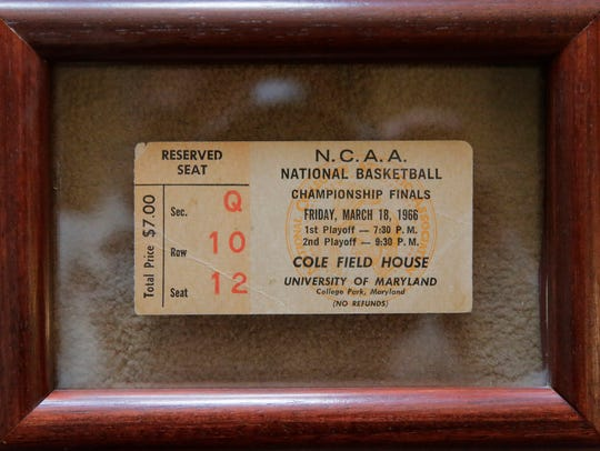 A framed ticket stub from the 1966 NCAA Championship