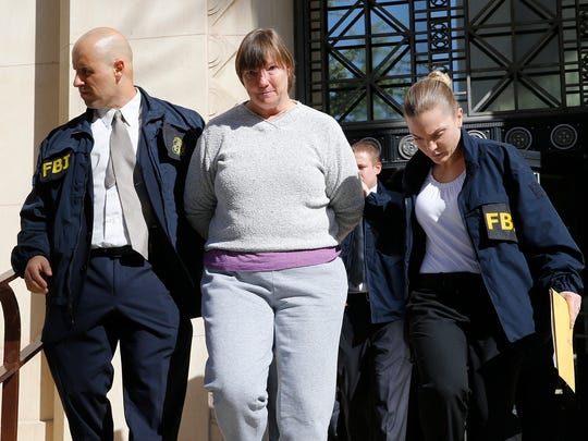 Former Austin High School Assistant Principal Diane Thomas is led to the El Paso County Jail after surrendering to the FBI in connection with the EPISD cheating scandal.