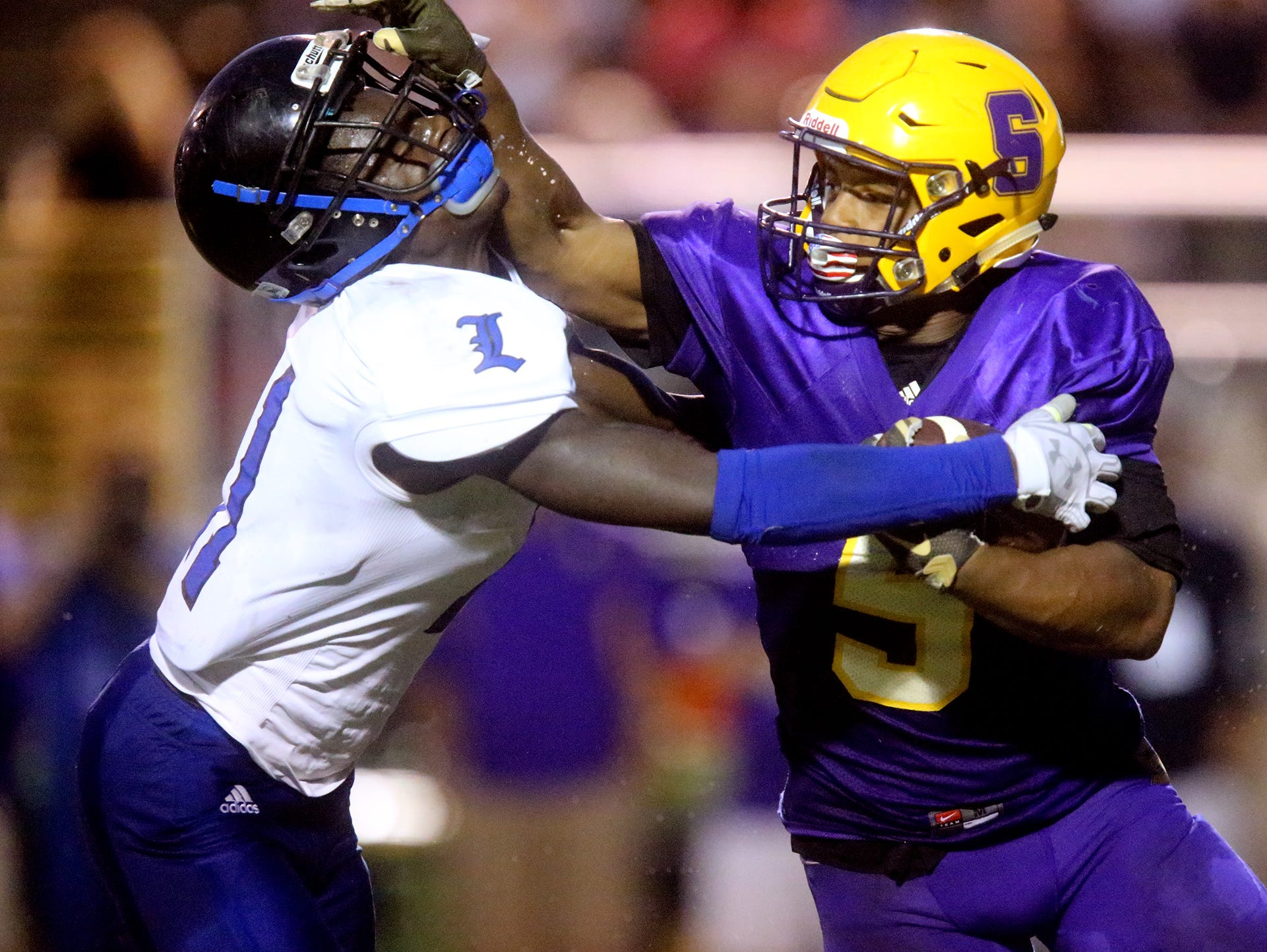 Smyrna's Casey Perkins (5) defends himself against La Vergne's Joevonte Norfork (11) as Casey runs the ball down the field during game one at Smyrna on Friday, Aug. 12, 2016.