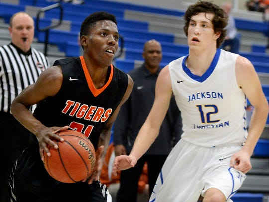 Middleton's John Gray prepares to go up for a shot while chased by Jackson Christian's Gunnar Lewis during their game Tuesday. Middleton defeated Jackson Christian, 61-46.