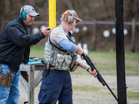 Scott Sheroky (left) prepares to start Kerry Walters during the 3-gun competition at the Lebanon County Police Combat Pistol Club on Saturday, April 1, 2017.