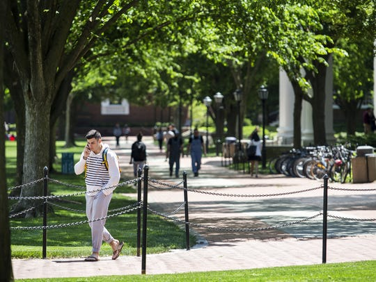 Students walk through the University of Delaware's