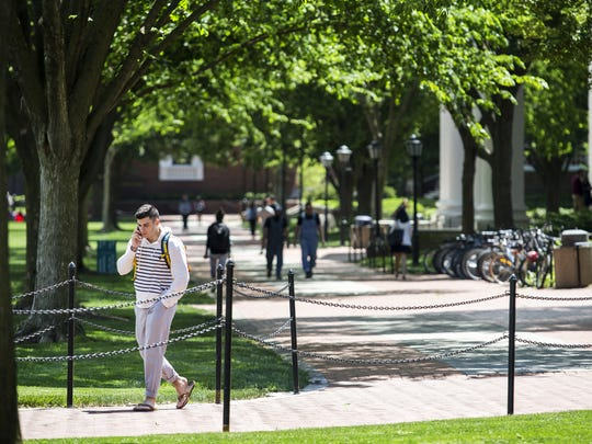 Students walk through the University of Delaware's campus in Newark in this 2016 file photo.