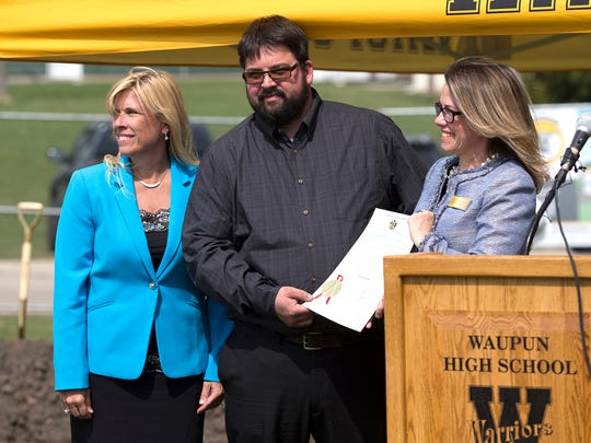Waupun School District Superintendent Tonya Olson and Technology Education Instructor Ryan Seichter receive a proclamation Tuesday, May 1, 2018 from Wisconsin Economic Development Corporation Vice President of International Business Development Katy Sinnott, stating that Governor Walker has declared May 1, 2018 Fab Lab Day. The district received $25,000 to help fund a 7000-square foot addition to the high school to teach technology education classes. School employees and students as well as state and local construction company  representatives were on hand for the ground breaking. Doug Raflik/USA TODAY NETWORK-Wisconsin