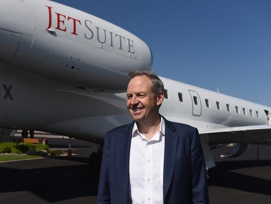 JetSuiteX CEO Alex Wilcox stands next to a JetSuiteX aircraft at Atlantic Aviation on June 7, 2018.