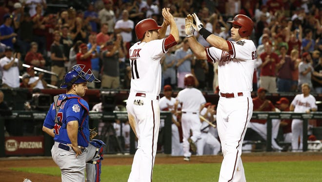 Diamondbacks first baseman Paul Goldschmidt hits a two-run home run against the Chicago Cubs in the 10th inning on Friday, May 22, 2015 at Chase Field in Phoenix, AZ.