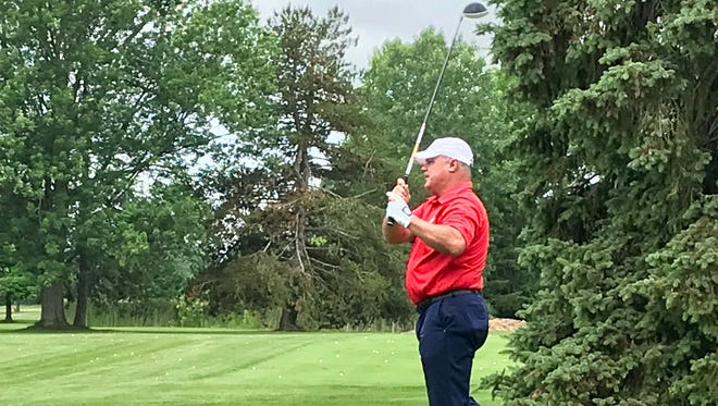 Former Ohio State football tailback Jeff Logan tees off on the first hole at the Marion Country Club Wednesday during the Marion County Youth Foundation's Charity Celebrity Golf Outing.