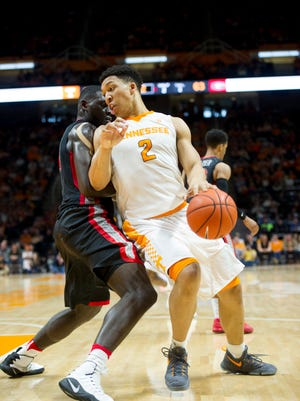 Tennessee's Grant Williams dribbles past Georgia's Derek Ogbeide during Saturday's game at Thompson-Boling Arena.