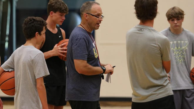 Westminster Christian Academy head coach Steve Crouse talks to his team near the start of practice on Wednesday, July 15, 2020