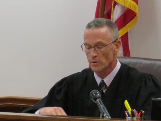 Broome County Court Judge Joseph Cawley announces the