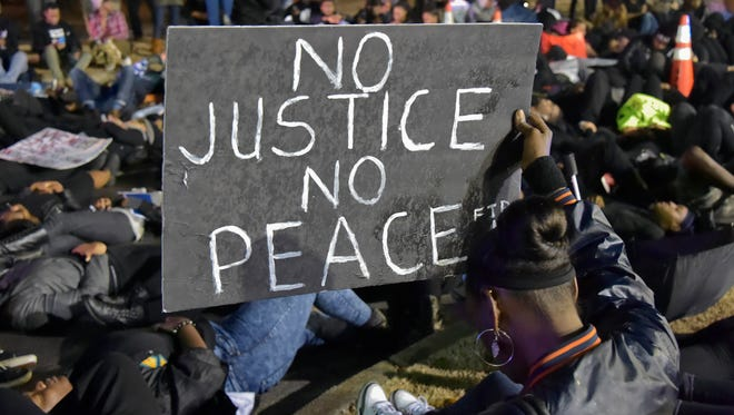 """Protesters hold two-minute """"die-in"""" in Alabama in response to a """"general pattern"""" of police brutality toward unarmed black citizens."""