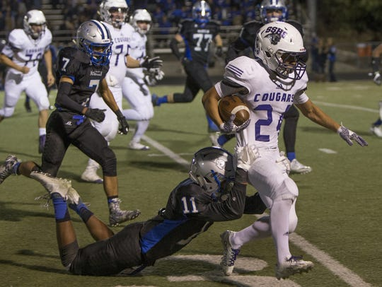 Spanish Springs running back Gabby Ordaz is grabbed