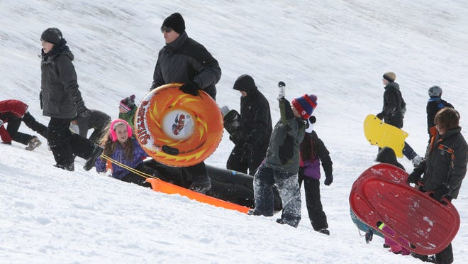 The sledding hill was busy Tuesday with school out for the day at Veterans Memorial Park in Orangeburg.