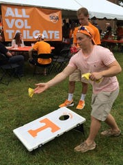 Jesse Clendenin pitches a beanbag in the SGA tailgate area before the game at Neyland Stadium, Aug. 31, 2014 in Knoxville.