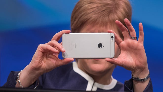 Scottish First Minister Nicola Sturgeon takes a picture with an iPhone on March 17. Apple is expected to release the iPhone 8 later this year.