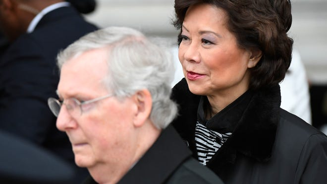 Transportation Secretary-designate Elaine Chao, and her husband, Senate Majority Leader Mitch McConnell of Ky. depart the 2017 Presidential Inauguration, Friday, Jan. 20, 2017, on Capitol Hill in Washington. (Jack Gruber/Pool Photo via AP)