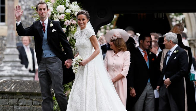 Pippa Middleton and James Matthews after their wedding at St Mark's Church in Englefield, England, May 20, 2017.