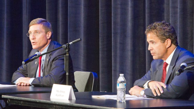 Democrat Eric Schertzing, left, and Republican Mike Bishop respond to questions about issues in their U.S. House contest at a forum Tuesday at the Brighton Center for the Performing Arts in Brighton. They'll face off Nov. 4 for the chance to succeed Rep. Mike Rogers.